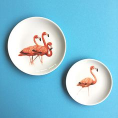Set of 2plates the Flamingosillustrations by Myrte. They look greattogether. One flamingo is a little ahead of the less courageous pack. You can enjoy our lovely plateshanging on a wall or on the table.   Set of twodifferentdiameters: 15 and 19cm / 6 and 7.5 inch  Made to order, please allow 3 weeks until delivery, unless stated the item is in stock.  Printed by handin The Netherlands  Made in limited edition  Print is fired into the glaze  Dishwasher safe  You can order a plate...