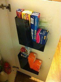 Magazine holders with Command strips, could even stick them to the underside of a cabinet shelf