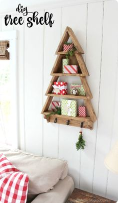 DIY Tree Shelf A DIY tutorial to build a tree shelf perfect for holiday decor. Free plans from Ana White make this an easy diy project for that special someone. Wood Christmas Tree, Christmas Tree Decorations, Christmas Fun, Xmas, Christmas Wood Crafts, Holiday Tree, Pottery Barn Christmas, Christmas Tree Storage, Pallet Christmas