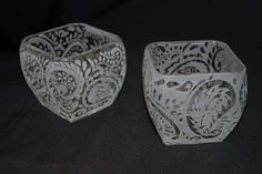 Reverse paisley designs on candle holders. Sold