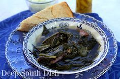 Southern seasoned collard greens made with smoked pork hocks, or other smoked meats, and served with raw onion, vinegar pepper sauce and cornbread or hoecakes on the side.