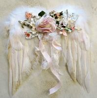 Angel wings with netting and a rose bouquet