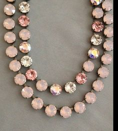 This is a 21 stone genuine Swarovski Crystal necklace. Each stone measures 8mm and is set in a nickel-free antique silver setting. This listing