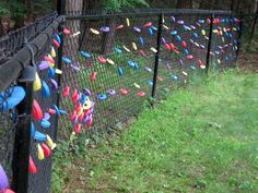 The original pin called for you to string the pool noodle slices into a garland.  Instead, I made a cut in each one and let my little boys hang them on the chain link fence individually.  So cute and colorful!  Idea from http://dollarstoremom.com/2012/05/make-a-pool-noodle-garland/
