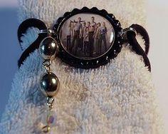 http://www.ebay.com/itm/Ladeda4u-Gina-THE-WALKING-DEAD-BRACELET-/271291306389?pt=US_Charm_Charm_Bracelets&hash=item3f2a38d195