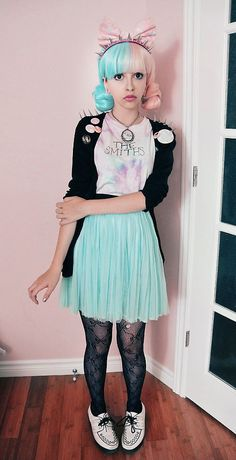 Pastel Tie-Dyed Smiths T, A Black Shoulder Studded Cardigan, Two-Tone Wig, Pastel Pink Ribbon, Black Lace Bow Tights, and White Docker Creepers - http://ninjacosmico.com/16-fashion-tips-how-to-dress-fairy-kei/