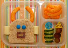 R is for..... Robot - - A robot sandwich make with cheese curls, blue M&Ms, string cheese,    and fruit leather for the mouth - Cheese C...
