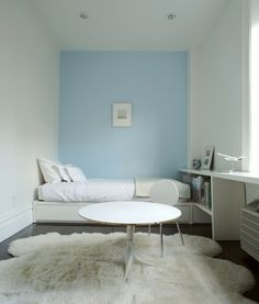 I love this serene room with the single coloured accent wall