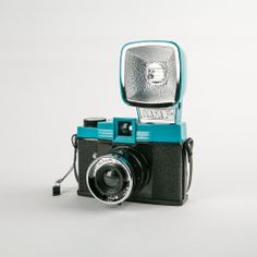 DIANA F+ CAMERA: A twist on the cult classic 60's Diana camera, the Diana F+ produces dreamy, radiant, lo-fi images on 120 film. The same look, the same quality - But the modified version also allows you to take pinhole photos and is compatible with an entire line of Diana F+ accessories. The Diana F+ package includes the plug-it-in-and-fire-away Diana+ Flash and comes with a set of color gel filters for colorsplashing your shots!