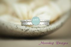 Size 8 Flat Twist Ring Set with Aquamarine by MoonkistGallery. This unusual aquamarine bezel-set gemstone ring set features a lovely aquamarine cabochon in sterling silver with a unique coordinating flat twist band. Historically, aquamarine was one of the first engagement stones. Visit moonkistgallery.etsy.com to see more pieces from this collection!  Repin this distinctive ring set to your own inspiration board!