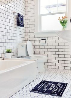 Haider and her husband managed to keep to a $5,000 budget while adding floor-to-ceiling subway tile—thanks in part to Haider's husband, who installed the tiles himself. The navy towel and floor mat are from H&M. Read the full profile over on Nubby Twiglet.