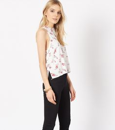 Floral tank with back ties. Wear with high waisted black jeans or light blue jeans by Dynamite Clothing