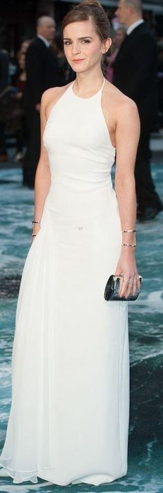 Who made Emma Watson's white halter gown, jewelry, and shoes that she wore in London on March 31, 2014? Dress – Ralph Lauren Collection  Shoes – Jimmy Choo  Rings – Monica Vinader  Earrings – Anito Ko  Bracelet – Jennifer Fisher