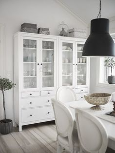White hutch in dining room