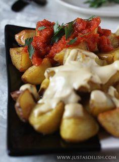 A twist on the popular Patatas Bravas and aioli with crispy roasted potatoes instead of fried potatoes.