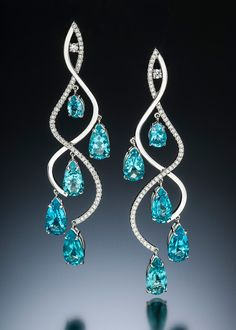 "Stilla earrings are graceful and dazzling.  This unique chandelier earring design features 20.04 carats of rare apatite from Madagascar with .90 carats total weight of accent diamonds set in curves of 14 karat white gold. Contact San Francisco or Laguna Beach galleries, or click ""Inquire"" for details or related custom design."