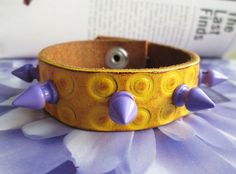 Yellow stamped leather candy boho spiked leather cuff by So cliché jewelry  https://www.facebook.com/soclichejewelry