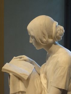 Statue of woman reading.