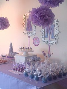 Monogrammed picture frames as a backdrop for dessert table