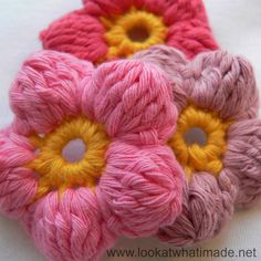I made these crochet cluster flowers using Kinga's 5 Petal Cluster Flower Pattern. Her pattern is clearly illustrated and very easy. I'm loving these!