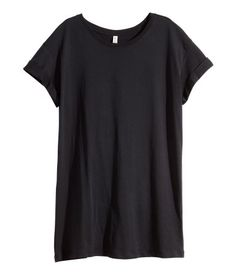 Gris. Camiseta larga en punto con costuras vueltas cosidas.