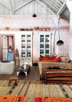 Bohemian living room with rugs and wallpaper