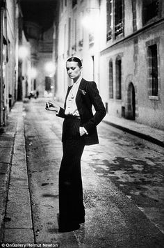 Rue Aubriot, taken in Paris in 1975, has become one of the most famous fashion photographs of all time for its depiction of actress and model Vibeke Knudsen wearing Yves Saint Laurent's cult Le Smoking in a deserted, lamplit street