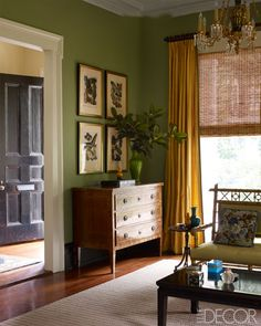 The pochoir prints in the front parlor are by Eugène Alain Séguy, and the olive-wood chest is Italian; the curtains are of a Claremont silk, and the heart-pine flooring is original.