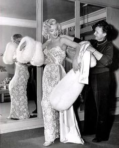 """Marilyn getting ready for the premiere of """"How To Marry a Millionaire"""", November 1953."""