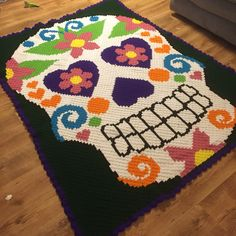 Corner to corner crochet afghan using a cross stitch graph from Joann. http://www.joann.com/cross-stitch-sugar-skull/3153868P200.html