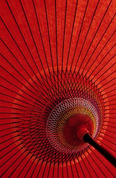 Detail of the red japanese umbrella used in tea ceremonies performed outdoors.