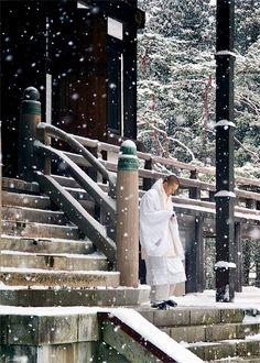 Monk in the snow at Koya-san, Japan