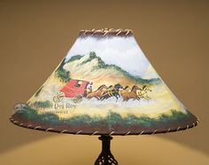 This is a rustic western painted lamp shade with fabulous hand painted artwork. Made from genuine pig skin suede leather and hand laced with real rawhide, this painted lampshade will always stay soft
