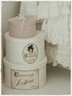 purchase hatboxes from wholesale company. paint in neutral shades. store antique linens, ribbons etc. within.