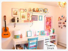 tween desk - put an extra long desk in the girls' room with shelving and picture rails over it.