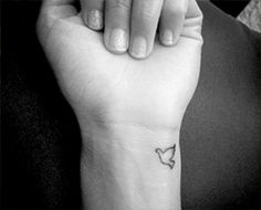 dove wrist tattoo - placement