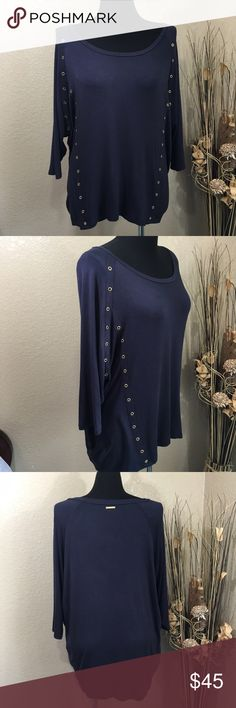 Michael Kors Navy Blue Tunic Brass Rivets Michael Kors Navy tunic with brass grommets asymmetrically set down the front and on each side at dolman sleeves and Michael Kors name plate on back of neck. Gently pre-loved condition. MICHAEL Michael Kors Tops