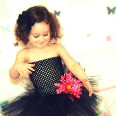 The picture you see above is ready to ship! Although you are more than welcome to customize your own! The length of this tutu is 9 inches, color is black, and the flower is pink with polka dots!   All of the flowers on my listings are 100% detatchable so you can put it anywhere you want on your tutu dress! (unless stated otherwise)  ***Please keep in mind each and every one of my tutus and tutu dresses are customizable- anywhere from length, to style, to colors!  Interested in this style but…