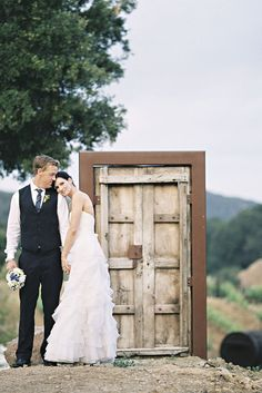 rustic door backdrop. oh my word, my obsession with doors makes me *really* want to do this.