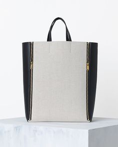 Celine Bag | Spring '14 collection.  Long tote wh/ elongates the body, sez Issac M.  Leather sides and gorg linen panel.    Zippers conjure mental picture of myself, expanding this bag to hold more lucsious freshness, this Spring at Farmer's Market...  Love!