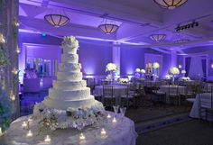A gorgeous wedding with blue uplighting featuring the venue of Belo Mansion