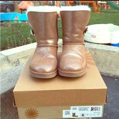 Swarovski Button Bling Ugg Bailey Shimmer 6 or 6.5 Very good condition, when foot is in, the creases are gone! I'm just selling these because I want a different pair... Confessions of a shopaholic ☺️ Paid $220 last  October.  UGG Shoes Ankle Boots & Booties