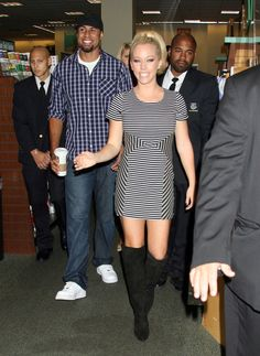 Kendra Wilkinson Day Dress - Kendra Wilkinson was casual chic at a book signing in LA. The reality starlet donned a striped mini dress paired with knee-high black boots.