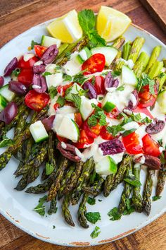Smokey grilled asparagus in a tasty tahini sauce with lemon and maple along with fresh diced tomatoes and cucumbers! Best Asparagus Recipe, How To Cook Asparagus, Grilled Asparagus, Brisket Flat, Smoked Brisket, Lemon Tahini Sauce, Veggie Side Dishes, Salad Ingredients, Summer Recipes
