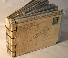bound postcards...on your travels, send yourself a postcard every day from where ever you are...then bind them when you return to have a journal of your trip complete with photos, stamps, and a run down of each day's events