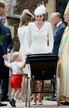 Catherine, Duchess of Cambridge, Prince William, Duke of Cambridge, Princess Charlotte of Cambridge and Prince George of Cambridge leave the Church of St Mary Magdalene on the Sandringham Estate with Archbishop of Canterbury Justin Welby (R) after the Christening of Princess Charlotte of Cambridge on July 5, 2015 in King's Lynn, England.
