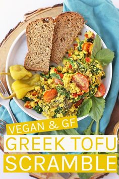 Start your day off right with this hearty and wholesome vegan Greek Tofu Scramble made with seasoned tofu, olives, spinach, and fresh tomatoes. The perfect plant based breakfast. Tofu Scramble, Raw Food Recipes, Vegetarian Recipes, Healthy Recipes, Vegan Food, Vegan Meals, Food Tips, Healthy Meals, Healthy Cooking