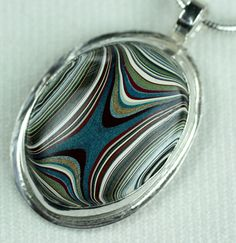 "Fordite Pendant ... ""Measured Lines"" for her"