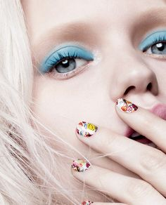Blue eyeshadow + floral nails.