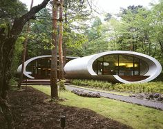 his is a remarkable house built in the woods of Karuizawa, Japan and designed by Kotaro Ide. The house is a vacation home (if only they rented this thing out) and was designed to withstand the seasonal hardships. The name, Shell House, is derived from the elliptical shell/wrapper forms which subtly represent a mollusk.    The best part about this house is the woodwork and how the structure meets with the cement all around the house.